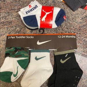 6 pairs of Nike and Puma socks